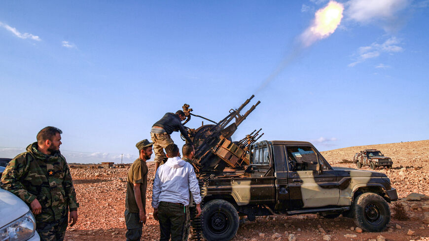 "An anti-aircraft gun fires rounds in tribute during the funeral of General Wanis Bukhamada, commander of the ""Saiqa"" (Special Forces) of the self-proclaimed Libyan National Army (LNA) loyal to strongman Khalifa Haftar, in the eastern city of Benghazi on Nov. 1, 2020."