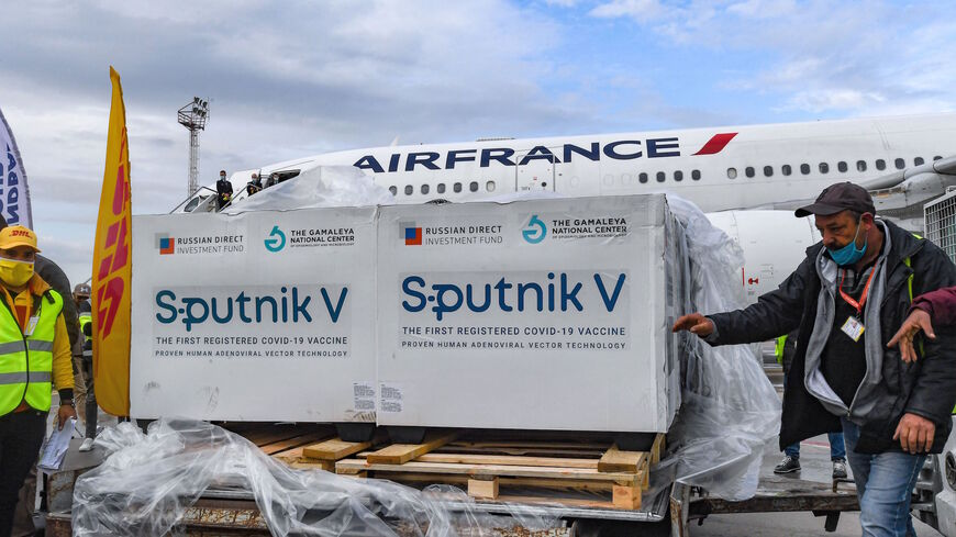 This picture taken on March 9, 2021 shows the arrival of a shipment of Russia's Sputnik V COVID-19 coronavirus vaccines in Tunisia's capital's Tunis-Carthage International Airport.