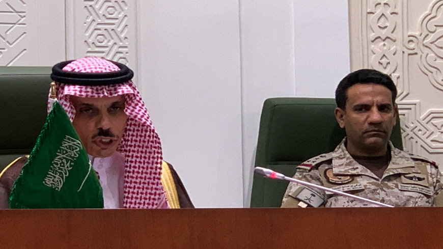 "Saudi Foreign Minister Faisal bin Farhan (L) speaks during a press conference in the capital Riyadh on March 22, 2021, announcing an offer of a ceasefire with Yemen's Huthi rebels. - Saudi Arabia offered Yemen's Huthi rebels a ""comprehensive"" ceasefire, among a series of proposals aimed at ending a catastrophic six-year conflict. The proposals include ""a comprehensive ceasefire across the country under the supervision of the United Nations"", a government statement said. (Photo by Fayez Nureldine / AFP)"