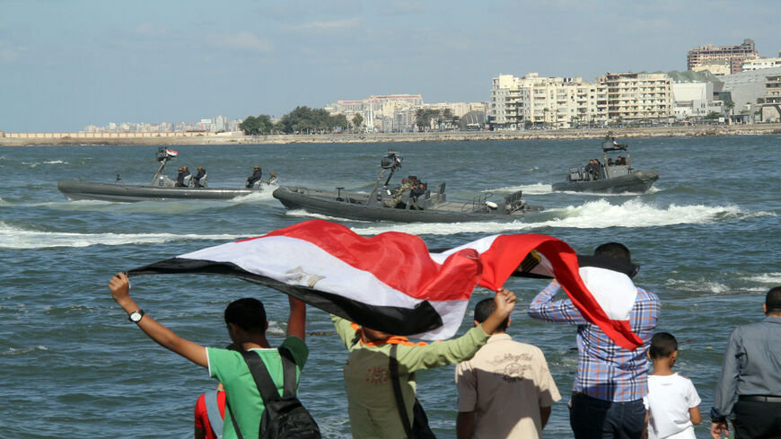 Egyptians celebrates as the navy puts on a display marking the 40th anniversary of the 1973 Arab-Israeli war, along the Mediterranean coastal city of Alexandria, Egypt, Oct. 6, 2013.