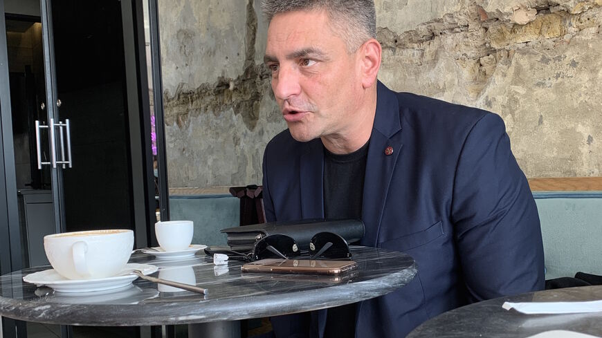 Yevgeny Fomenko, a Ukrainian entrepreneur who was held hostage by the PKK, is pictured at a cafe in Kyiv during an interview with Al-Monitor.