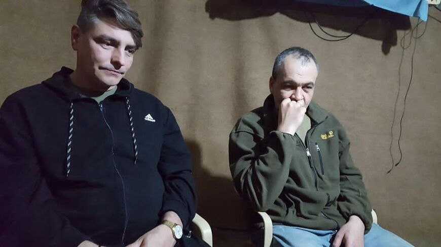Still from a proof of life video shot  June 3 2018 by the PKK showing Yevgeny Fomenko and Alexander Sanpiter