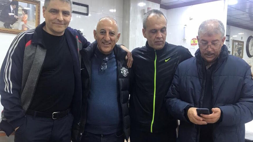 from left right Yevgeny Fomenko,  Nahro Ali (a Syrian Kurdish doctor from Ukraine) Alexander Sanpiter, Farhad Ali Shakir at a roadside restaurant en route from Dahuk to Erbil following the Ukrainians' release in December 2020. Courtesy of Nahro Ali