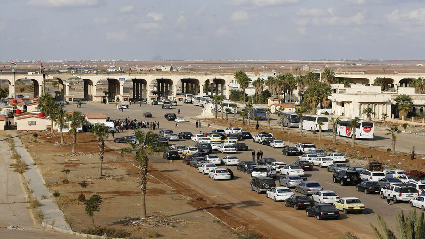 Vehicles wait to cross into Syria at the recently reopened Naseeb border post in Daraa province, at the Syrian-Jordanian border south of Damascus, Nov. 7, 2018.