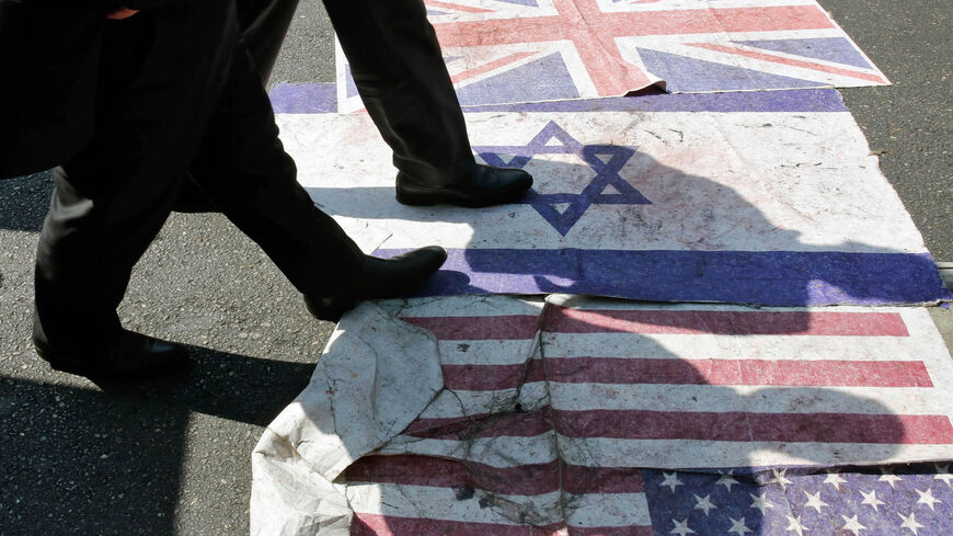 Iranians steps on the US, Israeli and British flag during a parade marking Quds Day, Tehran, Iran, May 31, 2019.