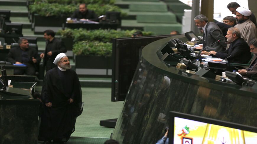 Iran's President Hassan Rouhani (L) arrives to address parliament in the capital, Tehran, on Sept. 3, 2019.
