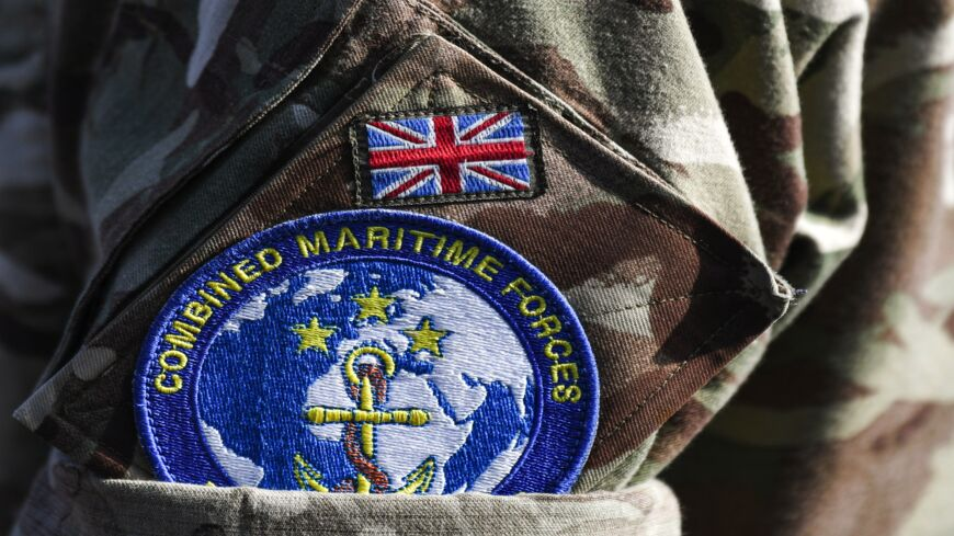 This picture taken on Nov. 5, 2019, during the International Maritime Exercise (IMX) in the Gulf waters off Bahrain shows a close-up of the badge of the Combined Maritime Forces (CMF) multinational naval partnership worn on the uniform of a British serviceman.