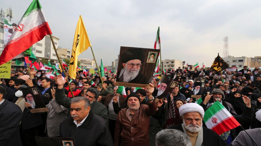 "Iranians holding national flags and pictures of the Islamic republic's supreme leader, Ayatollah Ali Khamenei, take part in a pro-government demonstration in the capital, Tehran's, central Enghelab Square on Nov. 25, 2019, to condemn days of ""rioting"" that Iran blames on its foreign foes. In a shock announcement 10 days ago, Iran raised the price of petrol by up to 200%, triggering nationwide protests in a country whose economy has been battered by US sanctions."