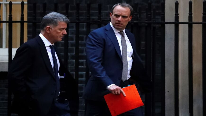 Britain's Foreign Secretary and First Secretary of State Dominic Raab (R) walks from the Foreign Office toward 10 Downing Street in central London on Jan. 6, 2020. The leaders of Germany, France and Britain on Sunday urged Iran to drop measures that go against the 2015 nuclear deal after Tehran announced it would no longer abide by a limit on enrichment.