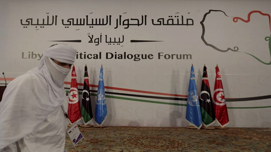 A delegate from Libya takes part in the Libyan Political Dialogue Forum hosted in Gammarth on the outskirts of Tunisia's capital, on Nov. 9, 2020. In October, the two main sides in the complex Libyan conflict signed a landmark cease-fire agreement.
