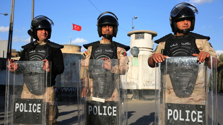Iraqi police protect Turkish embassy against protest