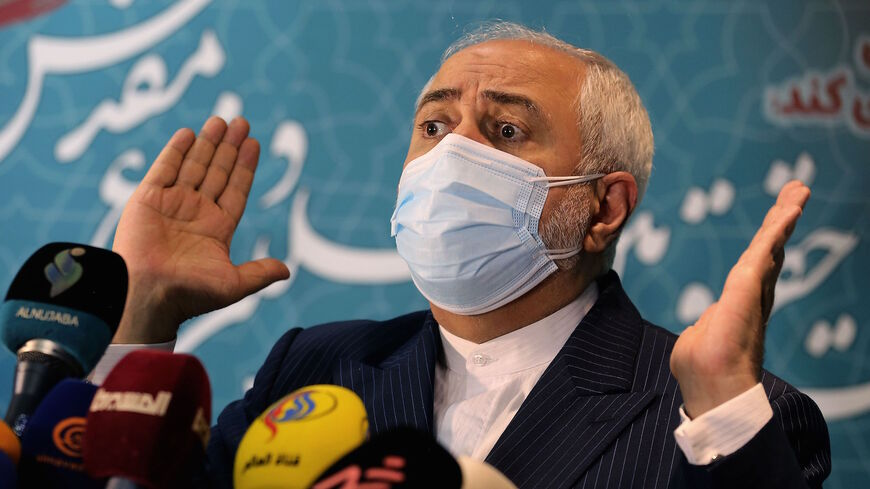 Iranian Foreign Minister Mohammad Javad Zarif speaks during a press conference at the International Conference on the Legal-International Claims of the Holy Defense in the capital Tehran on Feb. 23, 2021.