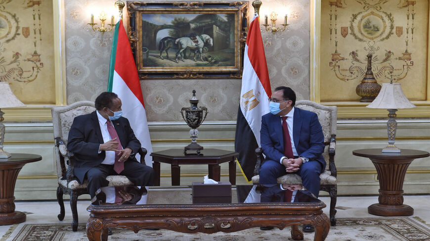 Egyptian Prime Minister Mostafa Madbouly (R) and his Sudanese counterpart Abdalla Hamdok meet in Cairo, Egypt, March 11, 2021.