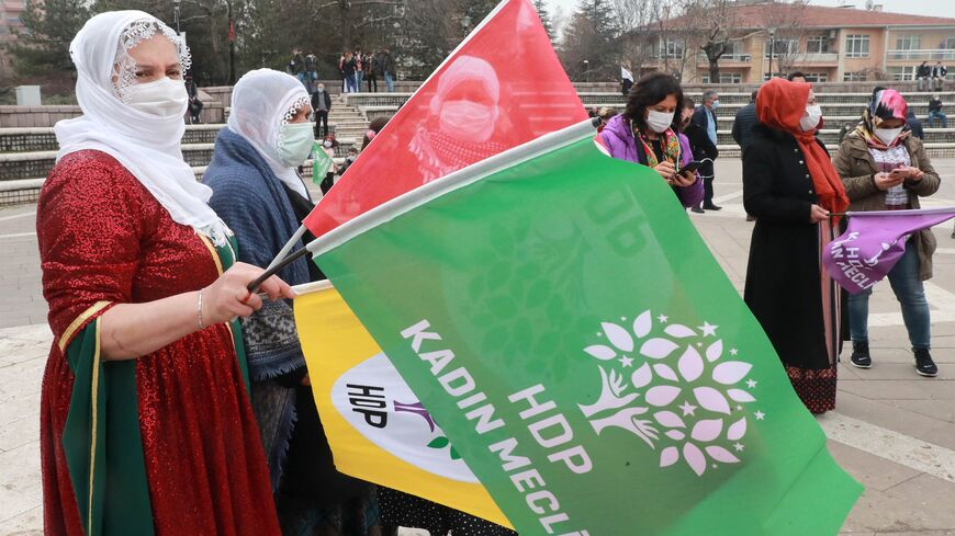 women wave hdp flags at newroz