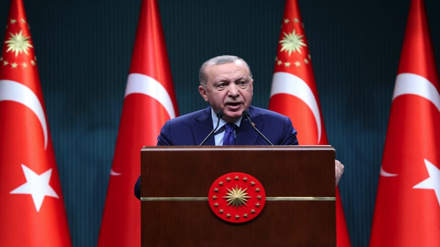 "Turkish President Recep Tayyip Erdogan delivers a speech following an evaluation meeting at the Presidential Complex in Ankara on April 5, 2021. Erdogan accused dozens of retired admirals of eyeing a ""political coup"" by attacking his plans for a canal linking the Black Sea to the Mediterranean."