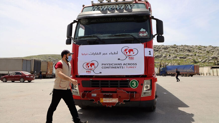 A truck carrying the first batch of AstraZeneca COVID-19 vaccines arrives at Bab al-Hawa border crossing between Syria and Turkey in Syria's rebel-held northwestern Idlib on April 21, 2021.