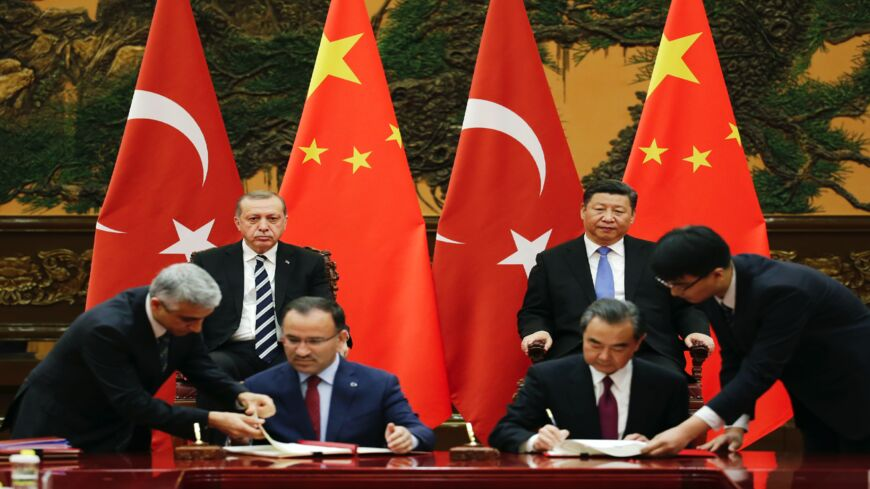 Turkish President Recep Tayyip Erdogan (back-L) and Chinese President Xi Jinping (back-R) attend a signing ceremony ahead of the Belt and Road Forum in Beijing on May 13, 2017.