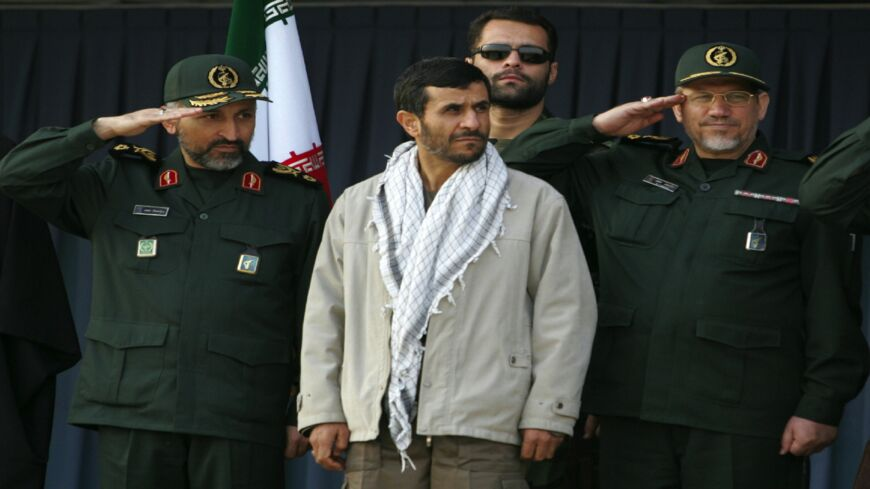 Iranian President Mahmoud Ahmadinejad (C) attends with Revolutionary Guards commander Yahya Rahim Safavi (R) and Basij senior official Mohammad Hejazi (L) a parade held by the Islamic volunteer Basij militia at the mausoleum of the late revolutionary founder Ayatollah Khomeini, just outside Tehran, Nov. 26, 2006.