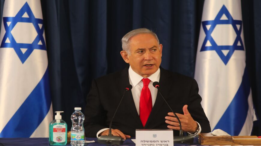 "Israeli Prime Minister Benjamin Netanyahu chairs the weekly cabinet meeting in Jerusalem on June 7, 2020. Netanyahu urged world powers to reimpose tough sanctions against Iran, vowing to curb Tehran's regional ""aggression"" hours after another deadly strike on pro-Iranian fighters in Syria."