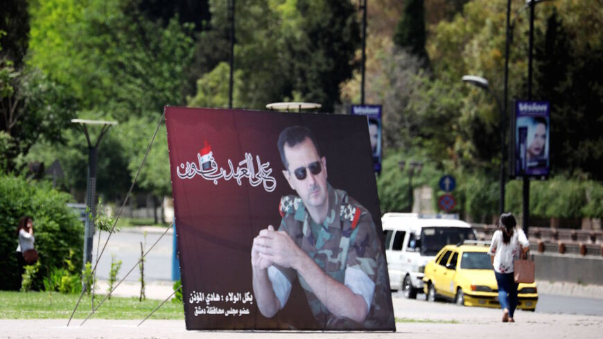 A photo taken on May 3, 2021 shows a giant portrait of President Bashar al-Assad at the Umawiyin square in Syria's capital Damascus, ahead of this month's presidential elections.