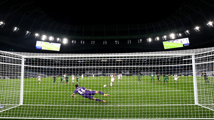 Harry Kane of Tottenham Hotspur scores his team's fifth goal from the penalty spot during the UEFA Europa League playoff match between Tottenham Hotspur and Maccabi Haifa at Tottenham Hotspur Stadium, London, United Kingdom, Oct. 01, 2020.