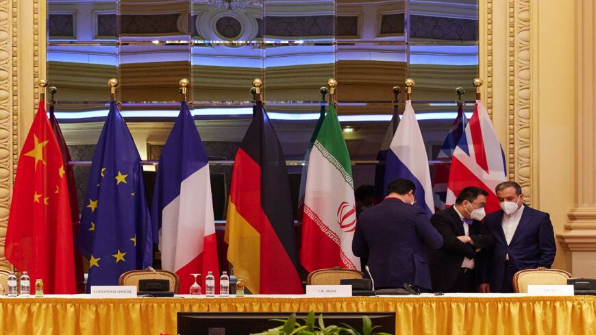 In this handout image provided by EU Delegation Vienna, Iranian Deputy Foreign Minister Abbas Araghchi (R) speaks with other participants at the JCPOA Iran nuclear talks on April 27, 2021, in Vienna, Austria.