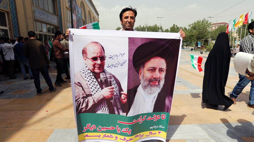 Raisi and Ghalibaf seen on poster