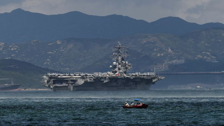 The US Navy's USS Ronald Reagan (CVN-76), a Nimitz-class, nuclear-powered supercarrier, sails in Hong Kong waters on October 2, 2017.