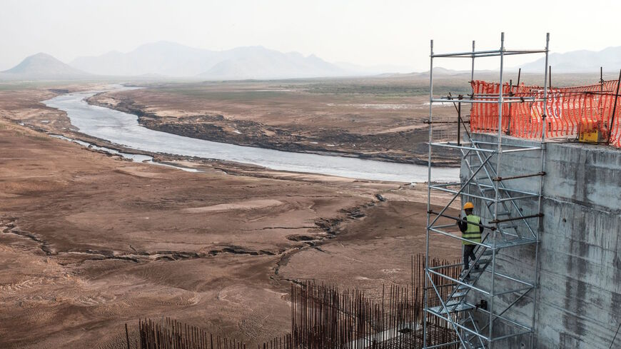A worker goes down a construction ladder at the Grand Ethiopian Renaissance Dam (GERD), near Guba in Ethiopia, on December 26, 2019.