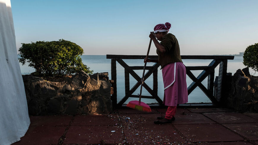 A worker cleans at a resort on the shore of Lake Tana, Bahir Dar, Ethiopia, Nov. 11, 2020. Lake Tana, a UNESCO biosphere reserve, is the origin of the Blue Nile River that feeds the Grand Ethiopian Renaissance Dam.