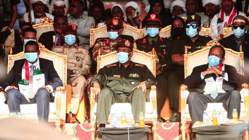 "(L to R front row) Gen. Mohamed Hamdan Daglo ""Hemeti"", deputy chairman of Sudan's Sovereignty Council, council chief General Abdel Fattah al-Burhan, and Prime Minister Abdalla Hamdok."