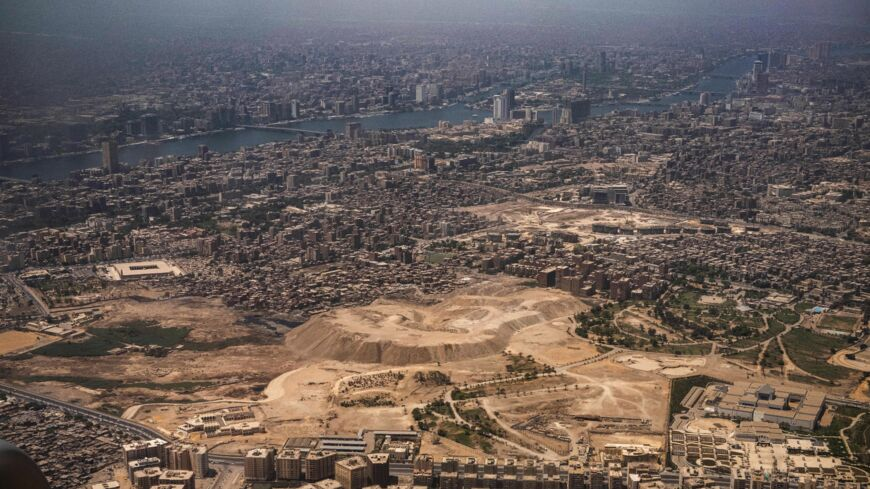 This picture taken on May 14, 2021, shows an aerial view            of Egypt's capital Cairo's Nile island of Manial al-Roda (top)            and the historic old Cairo district (bottom).