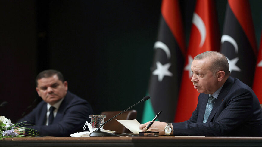 Turkish President Recep Tayyip Erdogan (R) and Libyan Government of National Unity Prime Minister Abdulhamid Dbeibeh attend a signing ceremony after their meeting at the presidential palace, Ankara, Turkey, April 12, 2021.