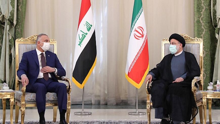 Iranian President Ebrahim Raisi (R) and Iraqi Prime Minister Mustafa al-Kadhimi (L) hold a joint press conference in Tehran, Iran, Sept. 12, 2021.