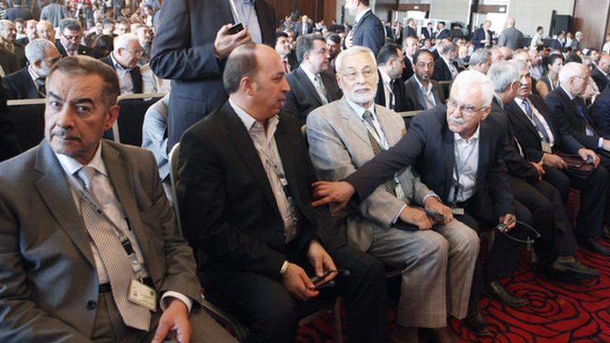 Members of Syria's opposition attend a Syrian opposition conference in Cairo July 2, 2012. Members of Syria's opposition and Arab and other foreign ministers begin a two-day conference in Cairo. REUTERS/Asmaa Waguih (EGYPT - Tags: POLITICS CIVIL UNREST)