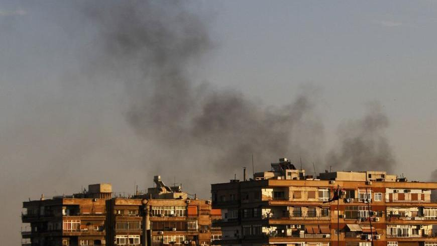 Smokes rises from the Qaboun area during clashes between the Syrian Free Army and Syrian army forces in Damascus October 10, 2012. REUTERS/Omar Khani      (SYRIA - Tags: CIVIL UNREST POLITICS)