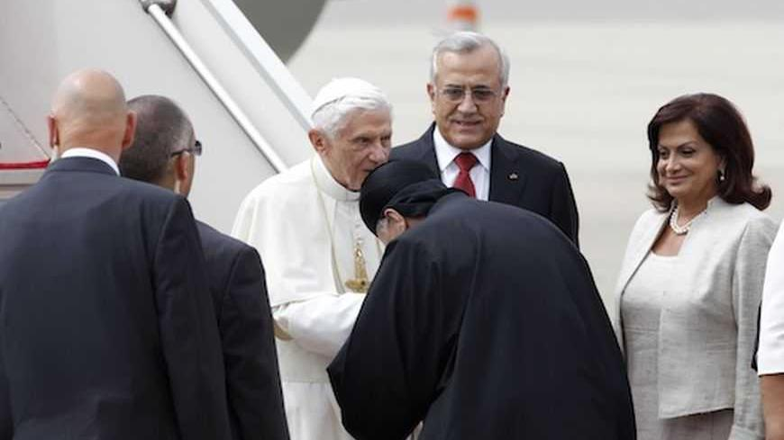 Pope Benedict XVI is greeted by the patriarch of Lebanese Christian Maronites, Bishara Boutros al-Rai, as Lebanon's President looks on upon  his arrival at Beirut's airport September, 14, 2012. REUTERS/ Jamal Saidi          (LEBANON - Tags: RELIGION POLITICS) - RTR37YUG