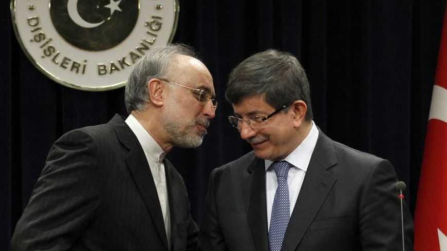 "Turkey's Foreign Minister Ahmet Davutoglu and his Iranian counterpart Ali Akbar Salehi (L) attend a news conference in Ankara January 19, 2012. Iran's foreign minister warned Arab neighbours on Thursday not to put themselves in a ""dangerous position"" by aligning themselves too closely with the United States in the escalating dispute over Tehran's nuclear activity. Iran has threatened to close the Strait of Hormuz, used for a third of the world's seaborne oil trade, if pending Western moves to ban Iranian cr"