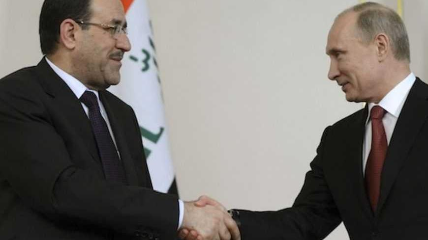 Russian President Vladimir Putin (R) shakes hands with Iraqi Prime Minister Nouri al-Maliki in his Novo-Ogaryovo residence outside Moscow October 10, 2012. Putin lobbied Iraq's prime minister on Wednesday to support Russian energy investment, as the oil arm of gas export monopoly Gazprom pushes for a foothold in the semi-autonomous region of Kurdistan.  REUTERS/Kirril Kudryavtsev/Pool  (RIUSSIA - Tags: POLITICS ENERGY) - RTR38ZTN