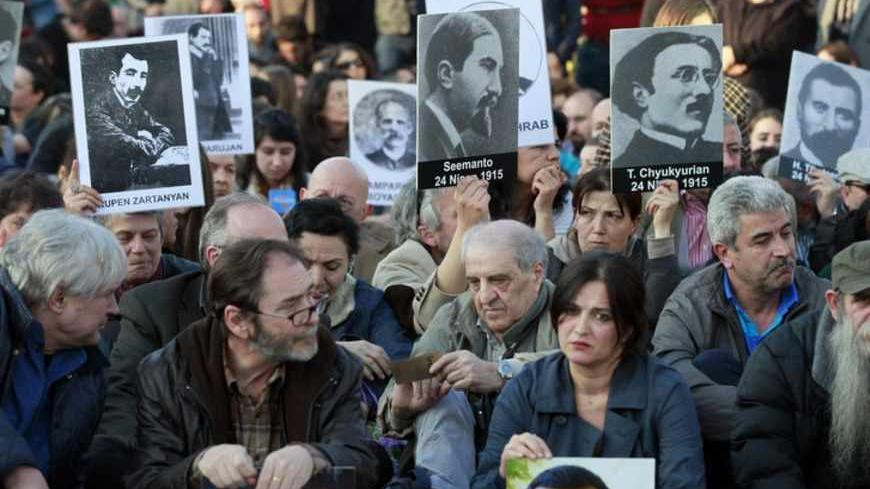 Human rights activists hold pictures of Armenian victims at Taksim square in central Istanbul April 24, 2013, during a demonstration to commemorate the 1915 mass killing of Armenians in the Ottoman Empire. REUTERS/Osman Orsal (TURKEY - Tags: ANNIVERSARY POLITICS CIVIL UNREST) - RTXYYDA