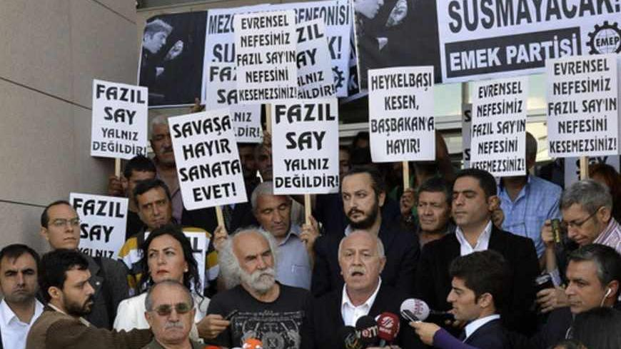 Supporters of Turkish classical pianist Fazil Say demonstrate in front of the court house in Istanbul October 18, 2012. Internationally acclaimed Turkish classical pianist Fazil Say goes on trial on charges of insulting Muslim religious values in comments posted on Twitter.  REUTERS/Burak Akbulut/Anadolu Agency (TURKEY - Tags: POLITICS CIVIL UNREST CRIME LAW) FOR EDITORIAL USE ONLY. NOT FOR SALE FOR MARKETING OR ADVERTISING CAMPAIGNS. THIS IMAGE HAS BEEN SUPPLIED BY A THIRD PARTY. IT IS DISTRIBUTED, EXACTLY