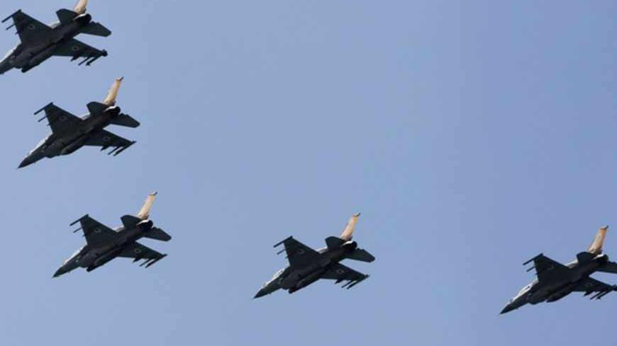 Israeli Air Force F-16 war planes fly in formation over the Mediterranean Sea as part of celebrations for Israel's Independence Day, marking the 65th anniversary of the creation of the state, April 16, 2013. REUTERS/Amir Cohen (ISRAEL - Tags: TRANSPORT MILITARY ANNIVERSARY) - RTXYO3U