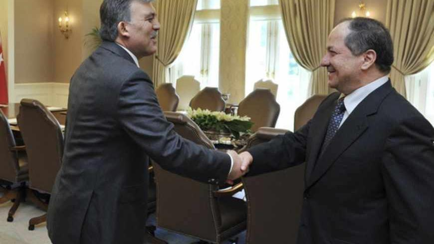 Turkish President Abdullah Gul (L) and Kurdistan Region President Masoud Barzani shake hands before their meeting at the Presidential Palace in Ankara April 20, 2012. REUTERS/Presidential Palace/Murat Cetinmuhurdar/Handout (TURKEY - Tags: POLITICS) FOR EDITORIAL USE ONLY. NOT FOR SALE FOR MARKETING OR ADVERTISING CAMPAIGNS. THIS IMAGE HAS BEEN SUPPLIED BY A THIRD PARTY. IT IS DISTRIBUTED, EXACTLY AS RECEIVED BY REUTERS, AS A SERVICE TO CLIENTS - RTR30ZAR