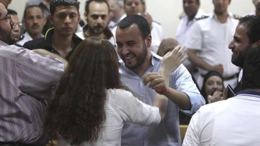 Friends of Egyptian suspects react after hearing the judge's verdict at a court room during a case against foreign non-governmental organisations (NGOs) in Cairo June 4, 2013. An Egyptian court sentenced at least 15 U.S. citizens in absentia to five years in jail on Tuesday and one American who stood trial was jailed for two years in a case against private foreign groups seeking to promote democracy.  Judge Makram Awad also ordered the closure of the NGOs, including the U.S.-based International Republican I