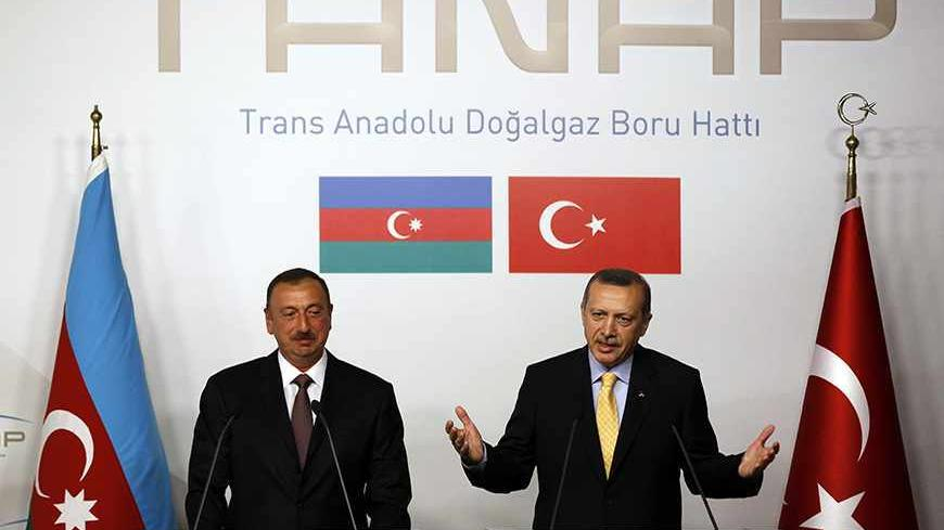 Turkey's Prime Minister Tayyip Erdogan (R) speaks as Azerbaijan's President Ilham Aliyev listens during a news conference following a signing ceremony in Istanbul June 26, 2012. Turkey and Azerbaijan signed an inter-governmental agreement on Tuesday on the $7 billion Trans-Anatolian natural gas pipeline project (TANAP), planned to carry Azeri natural gas across Turkey to Europe. Turkish Prime Minister Tayyip Erdogan and Azeri President Ilham Aliyev signed the deal at an Istanbul ceremony to launch a project