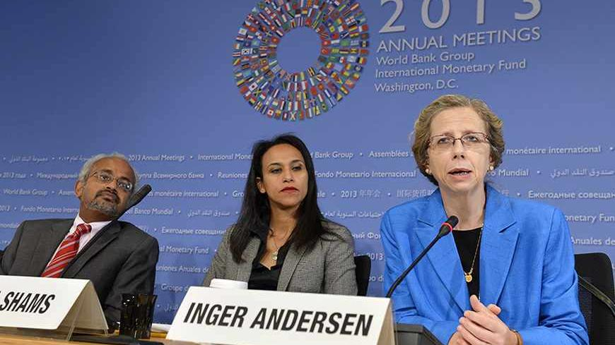 Inger Andersen, (R), the World Bank's Vice President for the Middle East and North Africa (MENA) region, makes remarks as Shanta Devarajan, (L), the World Bank's chief economist for MENA and communications manager Heba Shams listen, as she discusses political turmoil and economics in the region at a news conference during the IMF and World Bank's 2013 Annual Fall Meetings, in Washington, October 10, 2013. The meetings come at a time of economic uncertainty with the world's nations possibly slipping back int