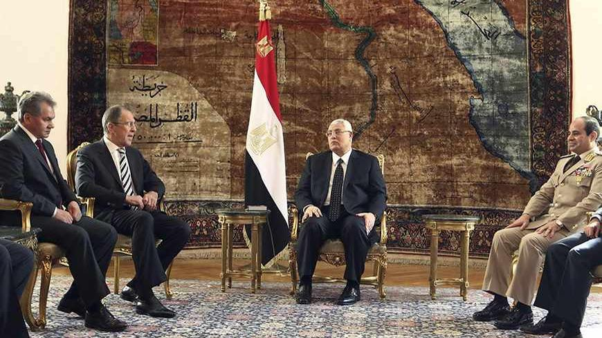 Egypt's interim President Adly Mansour (C), General Abdel Fattah al-Sisi (2nd R) and Foreign Minister Nabil Fahmy (R) meet with Russia's Foreign Minister Sergei Lavrov (2nd L) and Defence Minister Sergei Shoigu (L) at El-Thadiya presidential palace in Cairo, November 14, 2013. Sisi hailed a new era of defence cooperation with Russia on Thursday during a visit by Russian officials, signalling Egyptian efforts to revive ties with an old ally and send a message to Washington after it suspended military aid. RE