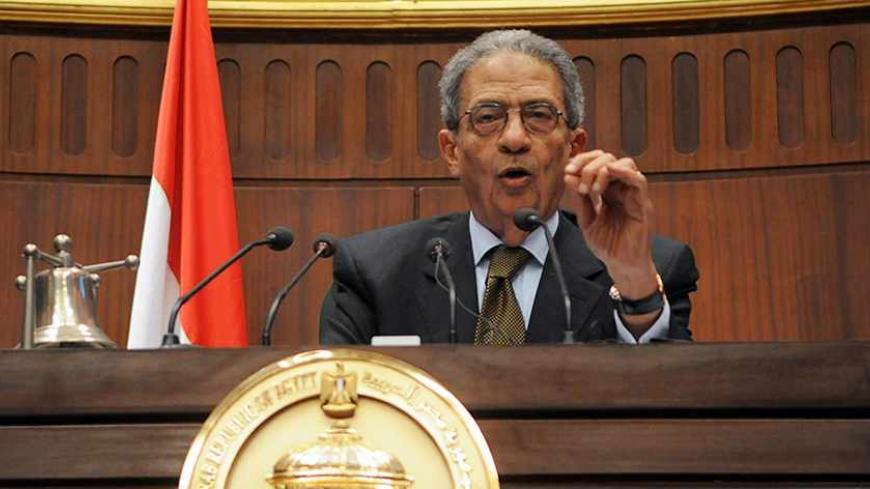 "Amr Moussa, head of the assembly writing Egypt's new constitution,speaks after they finished their vote at the Shura Council in Cairo December 1, 2013. A hardline Islamist leader said the army had driven Egypt to the ""edge of a precipice"", as a new constitution likely to ban Islamic political parties was set to be approved on Sunday by the panel that drafted it. The 50-member constituent assembly was due to finish voting on a draft that reflects how the balance of power has shifted in Egypt since secular-mi"