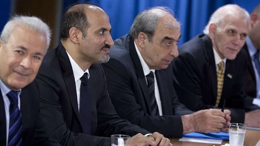 President of Syrian Opposition Coalition Ahmed Asi Al-Jerba (2nd L), along with members of the Syrian Opposition Coalition Dr. Burhan Ghalioun (L), Michel Kilo (3rd L) and Samir Shishakli (R) meet with U.S. Secretary of State John Kerry (not pictured) at the United States Mission to the United Nations in New York, July 25, 2013.    REUTERS/Carlo Allegri  (UNITED STATES - Tags: POLITICS) - RTX11Z6N