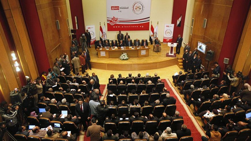 A general view shows a news conference, held by Supreme Election Committee head Nabil Salib (C) to announce a new constitution, in Cairo January 18, 2014. More than 98 percent of voters backed the new Egyptian constitution in a referendum this week, authorities said on Saturday, though the turnout was lower than some officials had indicated, with under 40 percent of the electorate taking part. REUTERS/ Mohamed Abd El Ghany (EGYPT - Tags: POLITICS) - RTX17JWD